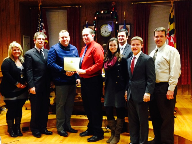 Members of the Allegany High School Marching Band Accept a Certificate of Recognition From the Mayor