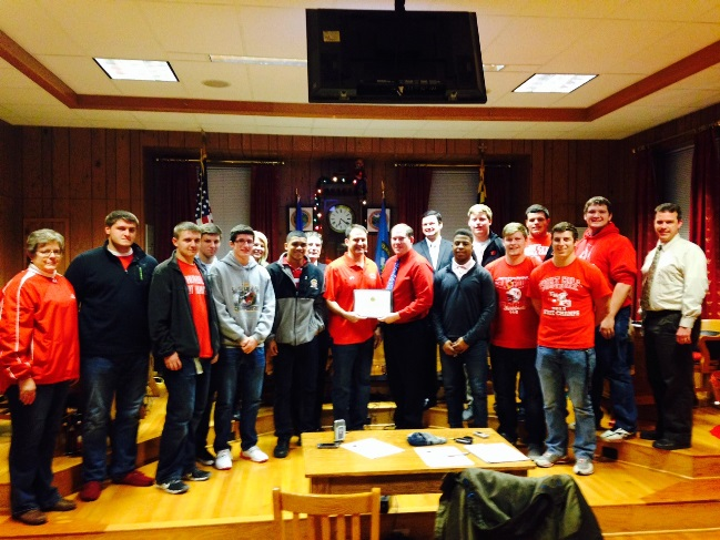 Members of the Fort Hill Varsity Football Team Accept a Certificate of Recognition From the Mayor an
