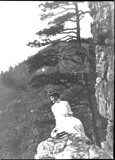 Woman Sitting on a Rock